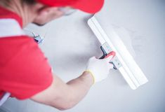 Drywall Patch by Worker. Drywall Patch by Construction Worker. Closeup Photo Stock Photography