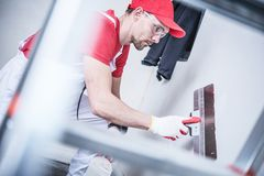 Drywall Prepare For Paint. Drywall Patching by Caucasian Homes Remodeling Worker royalty free stock photography