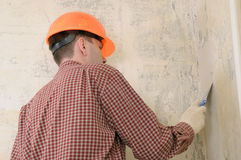 Drywall taping contractor. Wearing in helmet Royalty Free Stock Photos