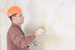 Drywall taping contractor. Wearing in helmet Stock Photography