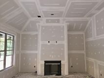 Drywall Taping and Plastering. Drywall being taped, plastered and  installed in a new construction home Stock Photos