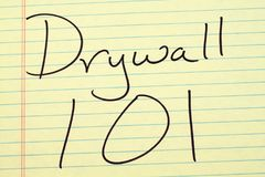 Drywall 101 On A Yellow Legal Pad Stock Photography
