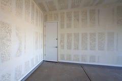 Drywallkonstruktion av ett garage Royaltyfri Bild