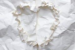 Drzejący zmięty papierowy kierowy kształt Obrazy Stock