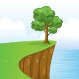 Drzewo na falezy scenerii z trawą, morzem, niebem I chmurami, Zdjęcia Stock