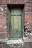 Drzwi w ściana z cegieł obraz stock