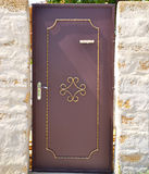 Drzwi w kamiennym ogrodzeniu Fotografia Royalty Free