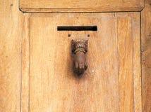 Drzwi z rękojeścią w formie ręki Fotografia Royalty Free