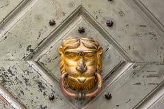 Drzwiowy knocker w formie twarz Zdjęcie Stock