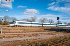 DSB IC4 regional diesel train arrives to Tollose train station. Tollose Denmark - February 24. 2018: DSB IC4 regional diesel train arrives to Tollose train Royalty Free Stock Photo
