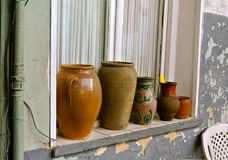 Old pottery on the outside window sill. Tbilisi, Georgia stock photography
