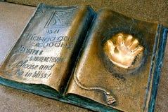 Golden handprint on metal monument. Freedom of choice. Kazakhstan, royalty free stock photo