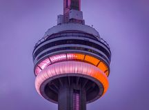 CN Tower at dusk, Toronto, Canada. Toronto, Canada-July 12, 2015: Toronto`s CN tower or Canadian National tower lit in red and white during the Canada`s Day royalty free stock images