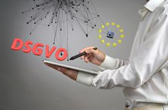 DSGVO, german version of GDPR. General Data Protection Regulation concept, the protection of personal data. Young man. With tablet computer works with a virtual Royalty Free Stock Photography