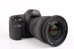 DSLR. Digital SLR camera with attached zoom lens Stock Photography