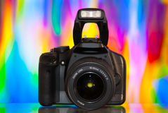 Dslr. Camera isolated on colorful background with reflection royalty free stock image