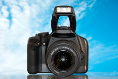 Dslr. Camera isolated on sky background with reflection royalty free stock images