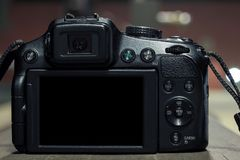DSLR on blurry background with lights stock photography