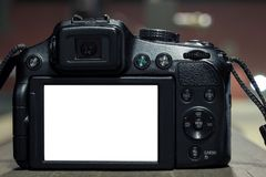 DSLR on blurry background with lights royalty free stock photo