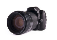DSLR camera. A DSLR camera mounted with a pro lens standard zoom royalty free stock images