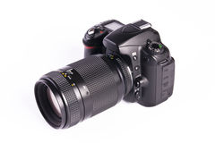 DSLR camera. A DSLR camera mounted with a pro lens standard zoom stock photography