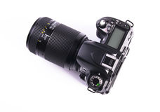 DSLR camera. A DSLR camera mounted with a pro lens standard zoom royalty free stock photo