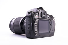 DSLR camera. A DSLR camera mounted with a pro lens standard zoom royalty free stock photos