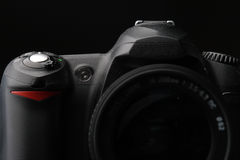 DSLR Camera. Frontal look of a dslr camera with zoom lens attached Royalty Free Stock Photography