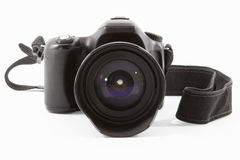 DSLR camera. Selective focus on a DSLR camera lens on white Royalty Free Stock Photography