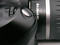 DSLR camera. Closeup of a digital SLR camera, focus on the shutter release button royalty free stock images