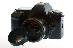 DSLR camera with a broken lens. On a white background Stock Images