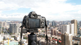 DSLR camera and city Stock Photography