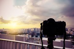 Dslr camera digital shooting on a cityscape sunset. A Dslr camera digital shooting on a cityscape sunset royalty free stock images