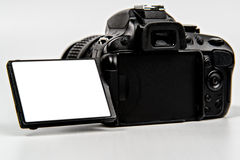 DSLR Camera with flip screen for placement. DSLR (Digital Single Lens Reflex) Camera with all logo and text removed. Blank screen for photo or text placement stock images