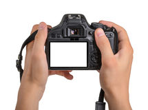 DSLR camera in hand isolated. On white background Stock Photos