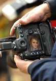 DSLR camera in hand showing screen preview Stock Image