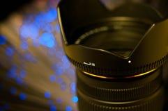 Dslr camera lens close up shot . Dslr camera lens close up shot , blue led background, on orange tone Stock Photo