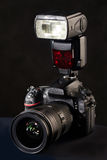 DSLR camera, lens and flash on black Royalty Free Stock Photo