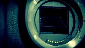 A dslr camera lens holder stock footage