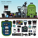 DSLR camera set. Thin line flat design of DSLR camera. Photography set packed on the shelf, details of this set rucksack, tripod, memory cards, usb cables  on Stock Images