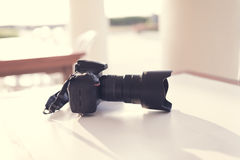 Dslr camera on the table with Morning sun light Stock Photography
