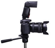 DSLR camera on tripod with external flash Royalty Free Stock Image