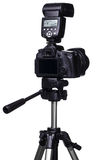 DSLR camera on tripod with external flash Stock Photos