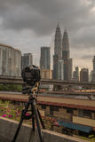 DSLR Camera on tripod photographing Petronas Towers Royalty Free Stock Image