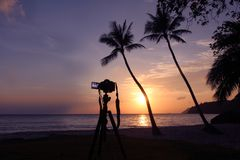 Dslr camera on a tripod while recording pictures of sunrise on t Stock Photography