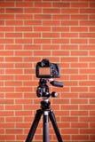 DSLR Camera on tripod shooting brick wall Stock Images