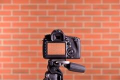 DSLR Camera on tripod shooting brick wall Stock Photos