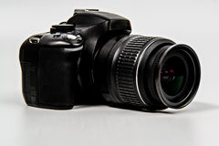 DSLR Camera with zoom lens angled Stock Photo