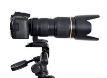 DSLR camera with zoom lense on a tripod. Isolated on white background Stock Images
