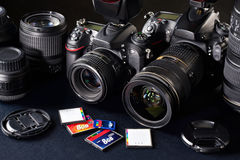 DSLR cameras, lens and flash cards royalty free stock images